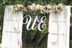 Wedding arch. Beautiful arrangement of flowers decorating a wedding ceremony arch Royalty Free Stock Images