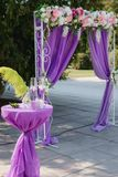 Wedding arch. Beautiful Wedding Ceremony. Wedding ceremony violet color Stock Photo