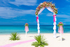Wedding arch, cabana, gazebo on tropical beach Stock Photo