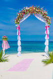 Wedding arch, cabana, gazebo on tropical beach Stock Images