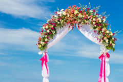 Wedding arch, cabana, gazebo on tropical beach Royalty Free Stock Photo