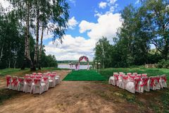 Wedding arch and chairs for a beautiful wedding ceremony. Outdoors Royalty Free Stock Images