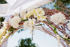 Wedding arch with chairs and many flowers Stock Images