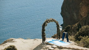 Wedding arch on cliff stock footage