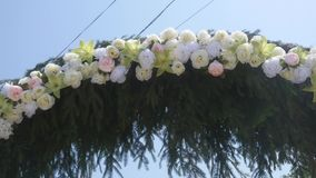 Wedding arch decorated with flowers. close up.  stock footage