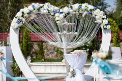 Wedding arch decorated with flowers outdoor Royalty Free Stock Images