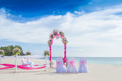 Wedding arch decorated with flowers on tropical beach, outd. Wedding arch decorated with flowers on tropical sand beach, outdoor beach wedding setup Royalty Free Stock Photos