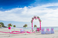 Wedding arch decorated with flowers on tropical beach, outd. Wedding arch decorated with flowers on tropical sand beach, outdoor beach wedding setup Royalty Free Stock Photo