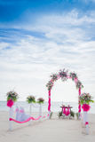 Wedding arch decorated with flowers on tropical beach, outd. Wedding arch decorated with flowers on tropical sand beach, outdoor beach wedding setup Royalty Free Stock Photography