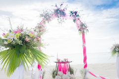 Wedding arch decorated with flowers on tropical beach, outd. Wedding arch decorated with flowers on tropical sand beach, outdoor beach wedding setup Stock Image