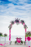 Wedding arch decorated with flowers on tropical beach, outd Stock Photography