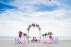 Wedding arch decorated with flowers on tropical beach, outd. Wedding arch decorated with flowers on tropical sand beach, outdoor beach wedding setup Stock Photos