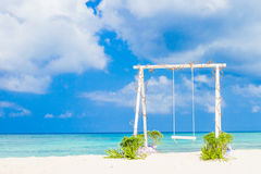Wedding arch decorated with flowers on tropical beach, outd. Wedding arch decorated with flowers on tropical sand beach, outdoor beach wedding setup Stock Photo
