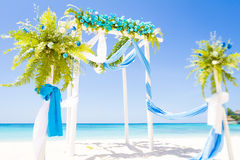 Wedding arch decorated with flowers on tropical beach, outd. Wedding arch decorated with flowers on tropical sand beach, outdoor beach wedding setup Royalty Free Stock Images