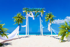 Wedding arch decorated with flowers on tropical beach, outd. Wedding arch decorated with flowers on tropical sand beach, outdoor beach wedding setup Stock Photography