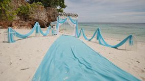 A wedding arch decorated with flowers on a tropical beach. Philippines. Bohol. A wedding arch decorated with flowers on a tropical beach. Philippines. Bohol stock video