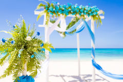 Wedding arch decorated with flowers on tropical sand beach, outd Stock Photos