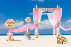 Wedding arch decorated with flowers on tropical sand beach, outd. Wedding arch - tent - decorated with flowers on beach, tropical wedding ceremony set up Stock Photography