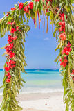 Wedding arch decorated with palm trees and flowers on Stock Photo