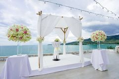 Wedding Arch Decoration, Flower, Floral, Beach Wedding Venue. The wedding venue, the arch with white theme with flower, floral, ocean in background Royalty Free Stock Image