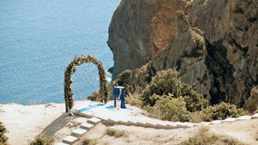 Wedding arch on edge of a cliff stock video