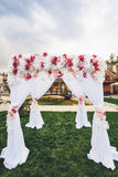 Wedding arch with floral decoration outdoors Royalty Free Stock Photo