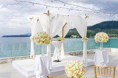 Wedding arch, Flower, Floral decoration, ocean and mountain view. The beautiful wedding venue at Cape Sienna, Koh Samui, Thailand. The ocean in the background Stock Images