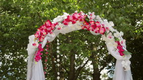 Wedding Arch with flowers on the grass stock video