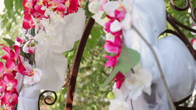 Wedding Arch with flowers on the grass stock video footage