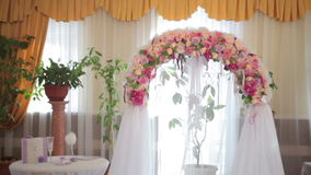 Wedding Arch with flowers indoor stock video footage