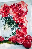 Wedding arch with flowers. The wedding arch by the river is decorated with flowers and pomegranate Royalty Free Stock Images