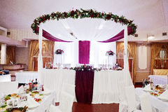 Wedding arch with flowers of table newlyweds. Royalty Free Stock Image