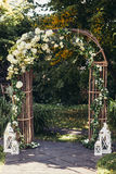 Wedding arch in forest. Wedding arch in rustic style standing in forest Stock Photo