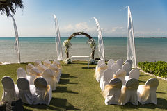Wedding arch in front of sea. Beautiful decorated wedding arch at the seaside Royalty Free Stock Images