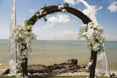 Wedding arch in front of sea. Beautiful decorated wedding arch at the seaside Royalty Free Stock Photo