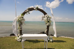 Wedding arch in front of sea. Beautiful decorated wedding arch at the seaside Stock Photography