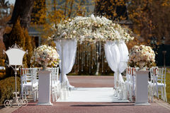 Wedding arch in the garden. Outdoors Stock Photography