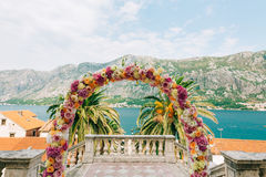 Wedding Arch of hydrangeas and roses. Wedding ceremony in the Ba Stock Photo