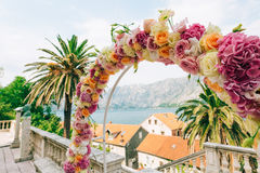 Wedding Arch of hydrangeas and roses. Wedding ceremony in the Ba Royalty Free Stock Images