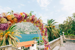 Wedding Arch of hydrangeas and roses. Wedding ceremony in the Ba Stock Photos
