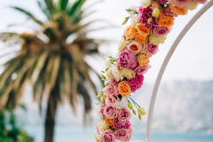 Wedding Arch of hydrangeas and roses. Wedding ceremony in the Ba Stock Images