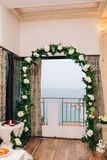 Wedding Arch inside restaurants. Wedding Arch inside Adrovichi restaurants in Montenegro, with a view of Sveti Stefan royalty free stock photo