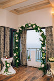 Wedding Arch inside restaurants. Wedding Arch inside Adrovichi restaurants in Montenegro, with a view of Sveti Stefan royalty free stock image