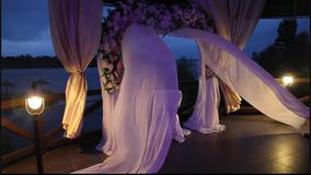Wedding arch on the lake stock video footage
