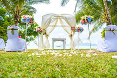 Wedding arch on the lawn near the beach. Wedding arch on the lawn near by the beach Royalty Free Stock Image