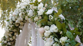 Wedding arch with natural roses stock video