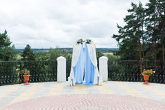 Wedding arch outside. Flowers arrangement decoration Stock Image
