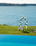 Wedding arch, pool and sea Royalty Free Stock Image