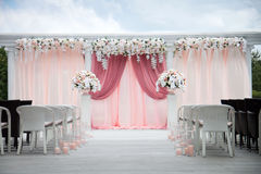 Wedding arch of real flowers. Floral design. Wedding decoration. Vector illustration, detail, isolated on white background Stock Photography