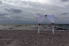 Wedding arch on seashore. Abstract background stock photography